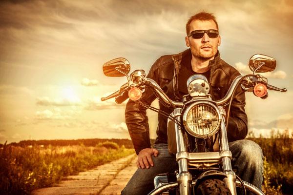 biker wearing sunglasses on motorcycle