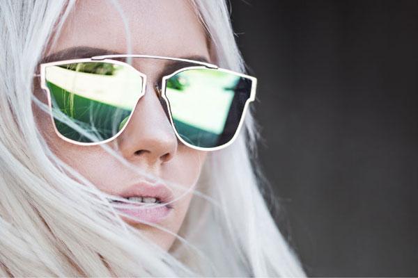 girl wearing flat lens sunglasses