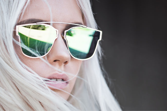 women in flat lens sunglasses