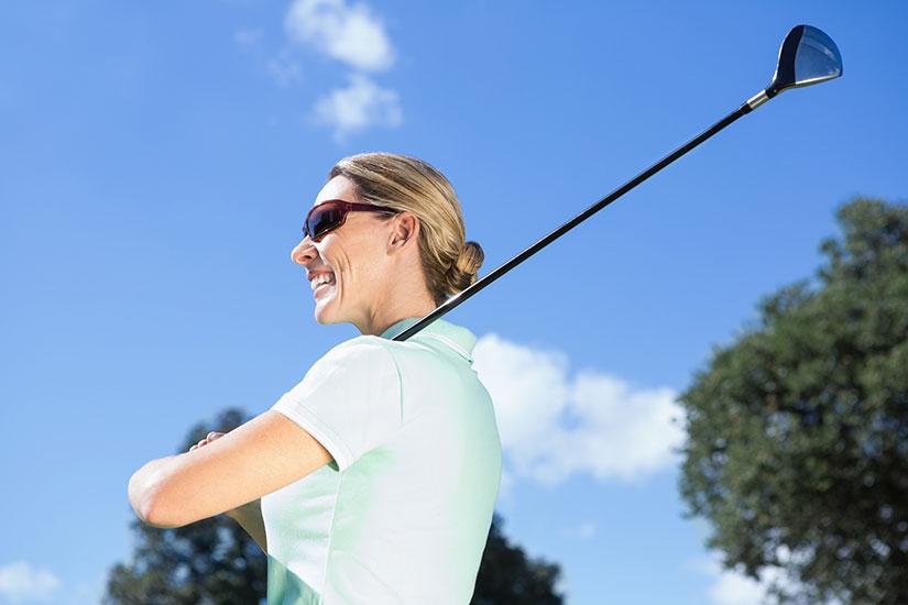 female golfer in sunglasses