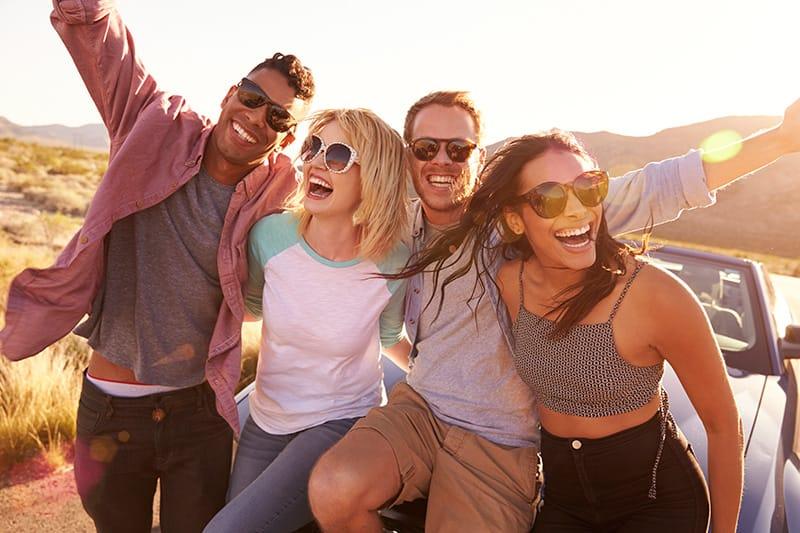 friends on road trip wearing sunglasses