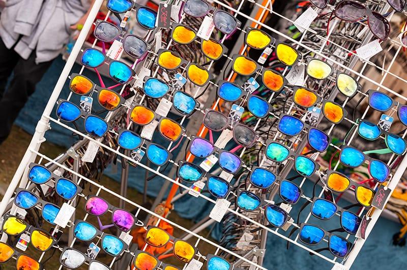 mirrored sunglasses on display rack
